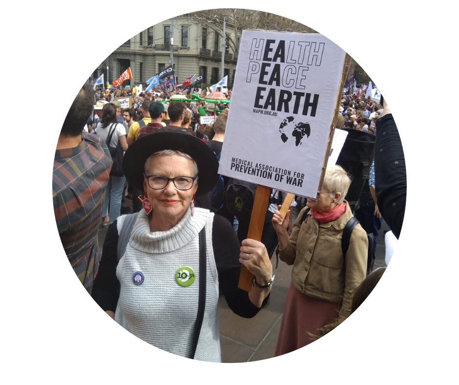 Dr Jenny Grounds holds a sign at the February Climate Strike